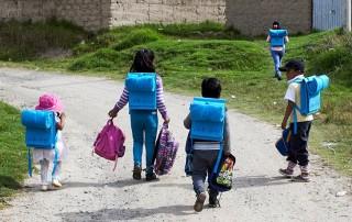 Kids wearing back packs